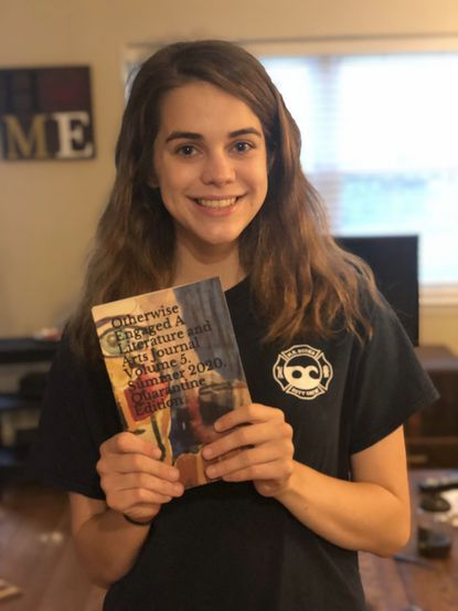 "Catonsville senior Claire Doll holds a copy of the literary journal that published her short story, entitled ""Flooded,"" based on the Ellicott City flood in 2018."