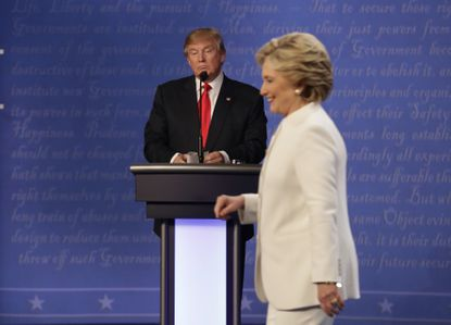 Republican presidential nominee Donald Trump waited behind his podium as Democratic presidential nominee Hillary Clinton made her way off the stage following the third presidential debate at UNLV in Las Vegas in 2016.