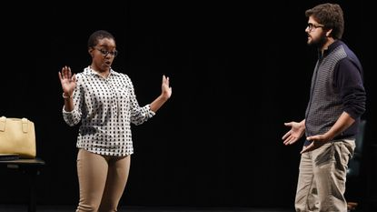 """Actors Asia Nicholson (Meridian), left, and Benjamin Hopkins (Mark) rehearse at Howard Community College (HCC) for the play """"In The Cotton,"""" an original work by playwright Morgan McGuire."""