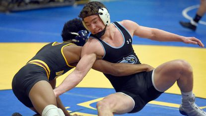 Westminster's Brad Walsh wrestles Dunbar's De'arrus Carr during The Duals at Westminster in the 145-pound weight class Dec. 28.
