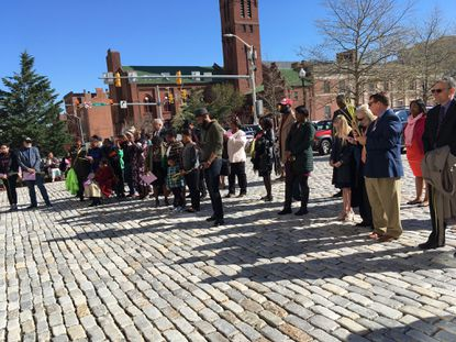Churches and congregants gather to bless the city of Baltimore on Palm Sunday.
