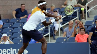 Frances Tiafoe returns a shot to Adrian Mannarino of France during the first round of the U.S. Open tennis tournament, Tuesday, Aug. 28, 2018, in New York.