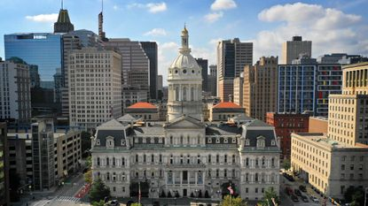 An aide in Baltimore Council President Brandon Scott's office said she was fired after applying to fill the council seat his elevation left vacant.