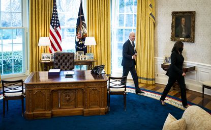 """President Joe Biden and Vice President Kamala Harris exit the Oval Office after the signing of the """"American Rescue Plan."""""""