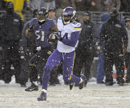 Minnesota's Cordarrelle Patterson distances himself from Ravens middle linebacker Daryl Smith on a fourth-quarter catch-and-run touchdown Sunday at M&T Bank Stadium.