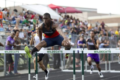 Donte Mitchell, seen here in this file photo from the outdoor track and field county meet, helped lead hosts Reservoir to the 3A East region title on May 15-16.