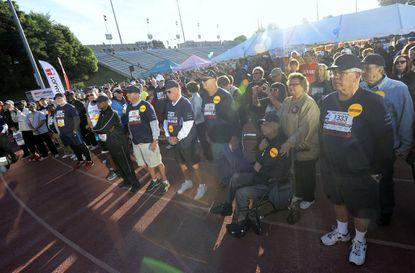 A crowd gathers before the start of the ZERO Prostate Cancer Run/Walk at Towson University's Johnny Unitas Stadium Sunday.