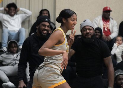 Fans react with St. Frances forward Angel Reese following her basket against St. Vincent Pallotti on Jan. 24, 2020.