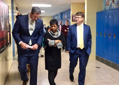 Baltimore County Executive Johnny Olszewski Jr., left, Maryland House Speaker Adrienne Jones and Baltimore County Council Tom Quirk join a tour of Lansdowne High School on Dec. 2, discussing its ongoing infrastructure issues and plans for replacement.