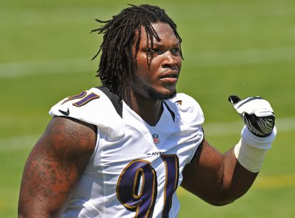Ravens rookie linebacker Courtney Upshaw works out during rookie camp in May.