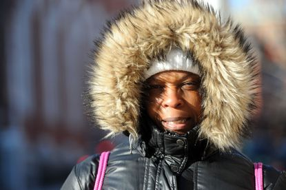 Ave Strawder, of Columbia, walks into the breeze as she makes her way to work on a day with record-breaking cold in Baltimore.