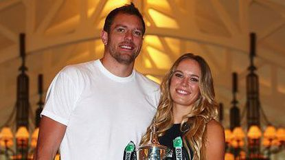 David Lee and Caroline Wozniacki pose for a photograph on Oct. 30, 2017, in Singapore. The two were married this weekend in Italy.
