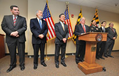 Governor-elect Larry Hogan, at podium, announced 6 cabinet-level appointees at a press conference. They are, from left, Joe Bartenfelder, Van Mitchell, Jimmy Rhee, Linda Singh, General Adjutant of Maryland, Ben Grumbles, and Charlie Evans.