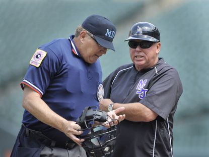 Mount St. Joseph baseball coach Dave Norton seen here in 2012 during the President's Cup championship game.