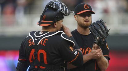 Baltimore Orioles catcher Jesus Sucre, left, visits at the mound with pitcher Alex Cobb after Cobb gave up three solo home runs in a row to the Minnesota Twins in the first inning Friday.