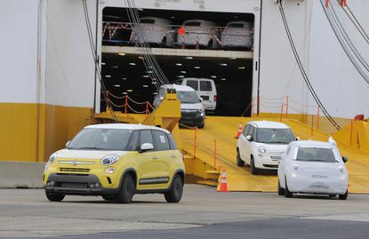 Baltimore,MD -- The Port of Baltimore, already the nation's No. 1 port for auto shipments, such imports of cars surge 20 percent last year. Fiats are unloaded in the port in this file photo from 2013.
