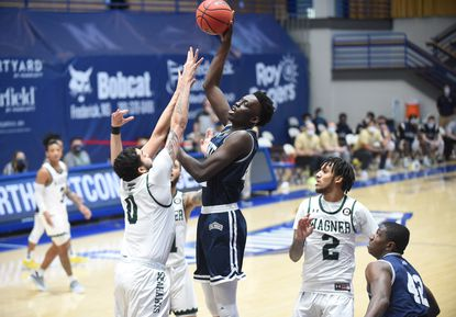 Mount St. Mary's Nana Opoku tries to release a shot over Wagner's Nigel Jackson during a mens basketball game at Mount St. Mary's Knott Arena on Wednesday, Feb. 17, 2021.