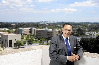 Freeman Hrabowski, president of UMBC, poses for a photo on the roof of the Administration Building at UMBC in Baltimore, MD on Wednesday, August 24, 2016.