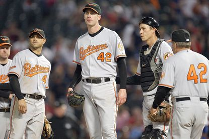From left, Orioles players Aubrey Huff, Brian Roberts, Mark Hendrickson and Chad Moeller wait for manager Dave Trembley (far right) to remove Hendrickson from the game against the Texas Rangers. Hendrickson allowed nine runs (two earned) in 3 2/3 innings.