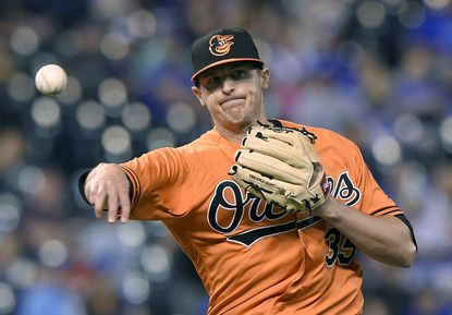 Orioles relief pitcher Brad Brach throws the Kansas City Royals' Omar Infante out at first base on a grounder to end agame on Saturday, April 23, 2016, at Kauffman Stadium in Kansas City, Missouri.