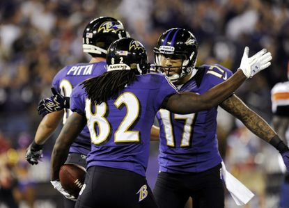 Torrey Smith celebrates his touchdown reception with teammate Tandon Doss during the first half of the Ravens' game against the Cleveland Browns in Baltimore Sept. 27.