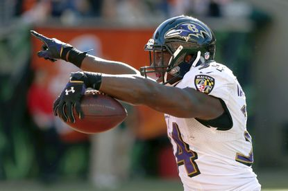 Ravens running back Lorenzo Taliaferro celebrates running in for a touchdown during the second half against the Cincinnati Bengals at Paul Brown Stadium.