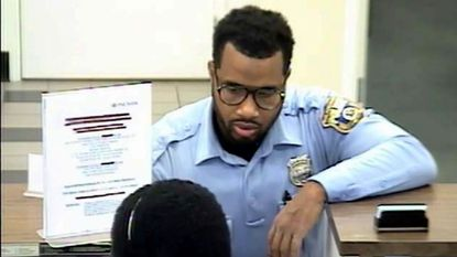 Bank surveillance video of Eric Troy Snell, a Philadelphia police officer indicted as part of the Gun Trace Task Force case.