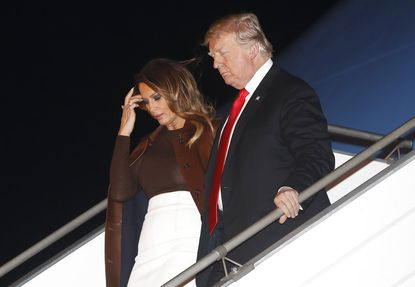 President Donald Trump and first lady Melania Trump walk from Air Force One, Thursday, Nov. 29, 2018, as they arrive at the Ministro Pistarini international airport in Buenos Aires, Argentina. Trump traveled to Argentina to attend the G20 summit.