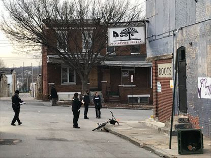 Police investigate a crime scene in the 100 block of N. Smallwood St. in the Penrose/Fayette Street Outreach neighborhood in West Baltimore on Thursday afternoon.