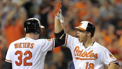 Orioles catcher Matt Wieters and first baseman Chris Davis will receive raises in 2015.