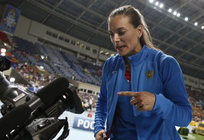Russian pole vaulter Yelena Isinbayeva, who is tasked with welcoming athletes at the Sochi Olympic, criticized fellow competitors for showing their support for LGBT rights while competing in Russia.