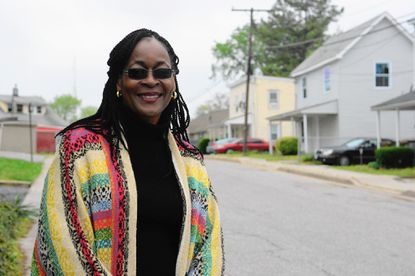 Charlotte Wood stands in front of homes to be repaired on Shipley Avenue in the Winters Lane community of Catonsville.
