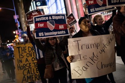 Members of Latino organizations march from the Trump Tower to NBC studios during a rally against Republican Presidential candidate Donald Trump on Saturday night, in New York City. Trump was host for NBC's Saturday Night Live. He has faced criticism during the campaign for his rhetoric and proposed immigration policies.