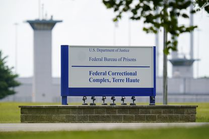 This Aug. 28, 2020, file photo shows the federal prison complex in Terre Haute, Ind. The Justice Department has scheduled three more federal executions during the lame-duck period before President-elect Joe Biden takes office, including two just days before his inauguration. In a court filing Friday night, Nov. 20, 2020 the Justice Department said it was scheduling the execution of Dustin Higgs for Jan. 15. (AP Photo/Michael Conroy, File)