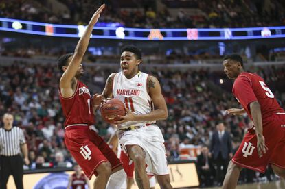 Maryland's Jared Nickens (11) drives against Indiana's James Blackmon Jr. (1) during the second half in a Big Ten Conference quarterfinal on Friday, March 13, 2015, at the United Center in Chicago.