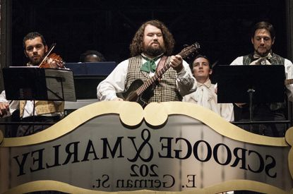 """Nick Delaney, center, performing in Cheseapeake Shakespeare Company's 2015 production of """"A Christmas Carol"""""""