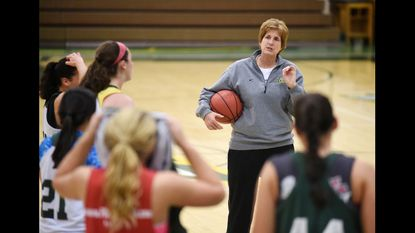 McDaniel women's basketball coach Becky Martin works with players during a practice in Westminster.