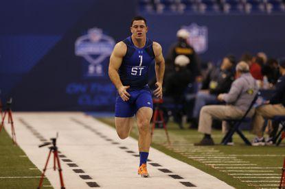Navy long snapper Joe Cardona runs the 40-yard dash at the NFL football scouting combine in Indianapolis, Feb. 20, 2015.