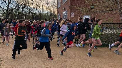 Hundreds of Stoneleigh Elementary students turn out before school for the new Morning Mile daily fitness program.