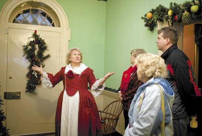 Maggie Jehn, of Ellicott City, gives a tour of the passageway of Montpelier Mansion during the annual candlelight tours, scheduled this year for Dec. 13 and 14.