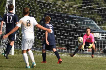 Gerstell keeper Daniel Burns gets in position to stop a shot by a Saints Peter & Paul opponent during a boys soccer game at Gerstell Academy on Wednesday, September 11.