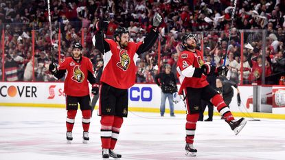 Ottawa Senators' Chris Wideman (6) and Bobby Ryan (9) celebrate after defeating the Pittsburgh Penguins in Game 6 of the Eastern Conference final during the 2017 Stanley Cup playoffs, Tuesday.