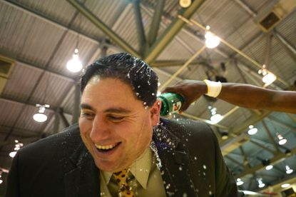 St. Paul's boys basketball coach Seth Goldberg is doused with water Feb. 16, 2014, after winning the MIAA B Conference championship.