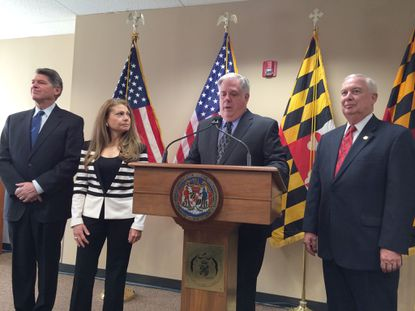 PHOTO BY MICHAEL DRESSER Gov.-elect Larry Hogan announces the appointments of (from left) Kenneth C. Holt as secretary of housing and community development; Rona E. Kramer as secretary of aging, and David R. Craig as planning secretary. Not in the picture is R. Michael Gill, named secretary of business and economic development.