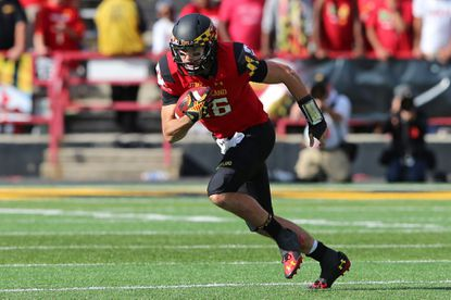 Maryland quarterback C.J. Brown takes off on a carry against Iowa at Byrd Stadium.