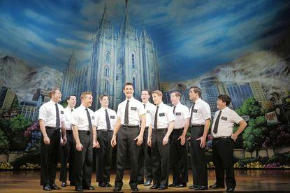 The Book of Mormon Mark Evens, center, in 'The Book of Mornon' at the Kennedy Center