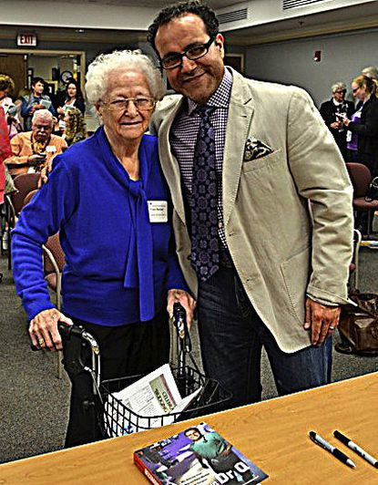 """Dr. Alfredo Quiñones-Hinojosa, right, who wrote the book """"Becoming Dr. Q: My Journey from Migrant Farm Worker to Brain Surgeon,"""" was special guest speaker at the Carroll Citizens for Racial Equality event. He is shown with Fran Bartlett, a founding member of the organization."""