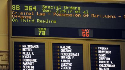 A vote tally board shows the final count in 2014 on a state Senate bill on marijuana legislation.
