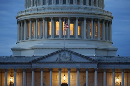 Light shines from inside the U.S. Capitol dome at dusk on Capitol Hill in Washington.