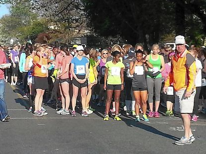 Participants line up for the start of the 5K by the Bay Run in Havre de Grace. More than 450 women and girls finished the race Sunday morning; it was won by Tezata Dengersa of Washington, D.C., in 17:16.9.